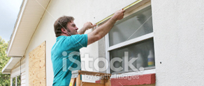 picture of man renovating a sash window